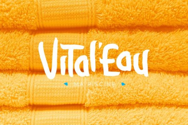 Logo Vital'Eau sur fond avec une image jaune